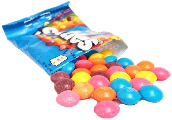 Wrigley, Tropical Skittles, kolorowe cukierki o smaku owoców egzotycznych, copyright Olga Kublik