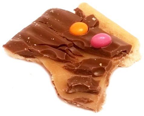 Solen, Papita z ciastkiem pokrytym mleczną czekoladą, karmelem i drażami, copyright Olga Kublik