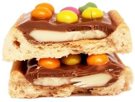 Solen, Papita z ciastkiem pokrytym mleczną czekoladą, kremem mlecznym i drażami, copyright Olga Kublik