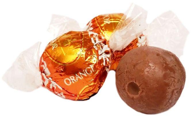 Lindt, Lindor Orange, pralinki z mlecznej czekolady z kremem pomarańczowym, świąteczna bombonierka, copyright Olga Kublik